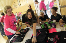 """<div class=""""source"""">ERIN L. MCCOY/The Kentucky Standard</div><div class=""""image-desc"""">Friends of Hannah Hamric, 14, who was severely injured after being hit by a truck Jan. 29, sell shirts at a benefit Friday. Proceeds will help cover Hamric's ongoing medical costs, as she remains in a coma at the Home of the Innocents in Louisville. Pictured wearing black """"Hope 4 Hannah"""" shirts are, from second to left, Alexis Hurst, 15, Alex Ballard, 14, and Anna Rogers, 15.</div><div class=""""buy-pic""""></div>"""