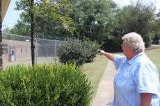 "<div class=""source"">ERIN L. MCCOY/The Kentucky Standard</div><div class=""image-desc"">Nelson County Jailer Dorcas Figg points to a section of the jail wall that was discovered to have a small hole where inmates were passing contraband about a year ago. Figg hopes the installation of cameras in that wing, which had none, will prevent future incidents.</div><div class=""buy-pic""><a href=""/photo_select/30012"">Buy this photo</a></div>"