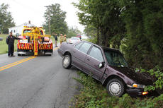 "<div class=""source"">ERIN L. MCCOY/The Kentucky Standard</div><div class=""image-desc"">A Honda Accord that hit a tree, then a fence, about 9 a.m. on Old Bloomfield Road is hauled off the shoulder by towers. Driver Amanda Cissell, 25, Bardstown, was transported to Flaget Memorial Hospital, while passenger Abby Day, Bloomfield, refused treatment.</div><div class=""buy-pic""><a href=""/photo_select/30168"">Buy this photo</a></div>"