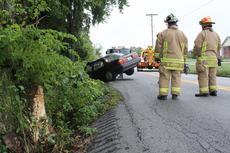 "<div class=""source"">ERIN L. MCCOY/The Kentucky Standard</div><div class=""image-desc"">Bardstown-Nelson County firefighters watch as a Honda Accord that hit a tree, seen at left, then a fence, on Old Bloomfield Road is hauled off the shoulder by towers. Driver Amanda Cissell, 25, Bardstown, was transported to Flaget Memorial Hospital, while passenger Abby Day, Bloomfield, refused treatment.</div><div class=""buy-pic""><a href=""/photo_select/30169"">Buy this photo</a></div>"