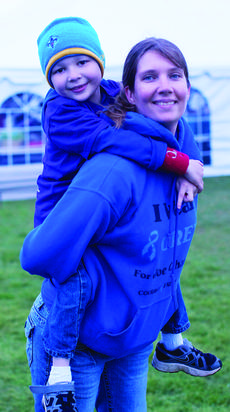 """<div class=""""source"""">RANDY PATRICK/The Kentucky Standard</div><div class=""""image-desc"""">Joe Charles O' Bryan, 7, who recently successfully completed his treatments for a brain tumor, gets a boost at the Relay from his aunt, Shannon Greene.</div><div class=""""buy-pic""""><a href=""""/photo_select/47042"""">Buy this photo</a></div>"""