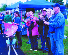 """<div class=""""source"""">RANDY PATRICK/The Kentucky Standard</div><div class=""""image-desc"""">Supporters applaud the cancer survivors as they make their way around the track.</div><div class=""""buy-pic""""><a href=""""/photo_select/47046"""">Buy this photo</a></div>"""