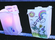 """<div class=""""source"""">RANDY PATRICK/The Kentucky Standard</div><div class=""""image-desc"""">Luminary candles line the track at Garnis Martin Field, celebrating the lives of the survivors and memorializing the victims of cancer.</div><div class=""""buy-pic""""><a href=""""/photo_select/47045"""">Buy this photo</a></div>"""