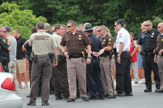 "<div class=""source"">RANDY PATRICK/The Kentucky Standard</div><div class=""image-desc"">Bardstown Police officers, Nelson County sheriff's deputies and other first responders gather outside Barlow Funeral Home after Officer Jason Ellis' body is brought back to Bardstown from the medical examiner's office in Louisville. A large procession of police, firefighters and emergency personnel made their way down I-65 and along Ky. 245 to the funeral home.</div><div class=""buy-pic""><a href=""http://web2.lcni5.com/cgi-bin/c2newbuyphoto.cgi?pub=191&orig=Police%2Bat%2BBarlow.jpg"" target=""_new"">Buy this photo</a></div>"