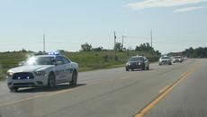 "<div class=""source"">JENNIFER CORBETT/The Kentucky Standard</div><div class=""image-desc"">A procession of local and surrounding cops cars drive in a procession on Ky. 245 Saturday morning. </div><div class=""buy-pic""><a href=""/photo_select/47356"">Buy this photo</a></div>"