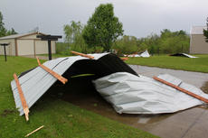 "<div class=""source"">ERIN L. MCCOY/The Kentucky Standard</div><div class=""image-desc"">High winds blew several sections of a roof from a neighboring barn into the yard of Art Redick at 6761 Louisville Road during a thunderstorm early Tuesday morning. Redick insisted he heard a tornado pass through about 4:30 a.m. ""It was a train sound. It was about 15, 20 seconds and it was over with,"" Redick said. </div><div class=""buy-pic""><a href=""http://web2.lcni5.com/cgi-bin/c2newbuyphoto.cgi?pub=191&orig=RoofDown.JPG"" target=""_new"">Buy this photo</a></div>"