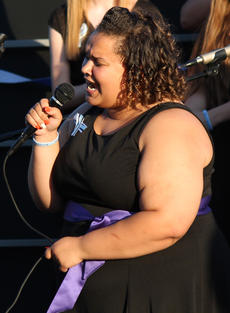 "<div class=""source"">RANDY PATRICK/The Kentucky Standard</div><div class=""image-desc"">April Henderson puts feeling into singing the lead for a Def Leppard song during the Tiger Chorale's memorial concert for her former classmate, Samantha Netherland, and her mom, Kathy Netherland, Saturday evening.</div><div class=""buy-pic""><a href=""http://web2.lcni5.com/cgi-bin/c2newbuyphoto.cgi?pub=191&orig=_april_singing_lead.jpg"" target=""_new"">Buy this photo</a></div>"