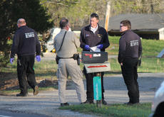 """<div class=""""source"""">RANDY PATRICK/The Kentucky Standard</div><div class=""""image-desc"""">Deputy Brian Adams talks with Nelson County EMS personnel while investigating a fatal accident on Springfield Road Thursday.</div><div class=""""buy-pic""""></div>"""