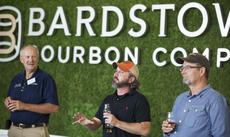 """<div class=""""source"""">FORREST BERKSHIRE/The Kentucky Standard</div><div class=""""image-desc"""">Brandon O'Daniel, head distiller for Copper & Kings, describes the taste profile for the first products launched by Bardstown Bourbon Company and C&K at the introduction event Friday alongside BBCo Master Distiller Steve nalley, left, and C&K President and CEO Joe Heron.</div><div class=""""buy-pic""""><a href=""""/photo_select/89283"""">Buy this photo</a></div>"""