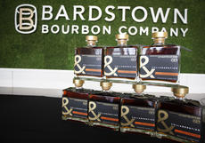 """<div class=""""source"""">FORREST BERKSHIRE/The Kentucky Standard</div><div class=""""image-desc"""">Bottles of one of the two products Bardstown Bourbon Company unveiled Friday, Collabor&tion, finished in Muscat Mistelle barrels, sit in the company's auditorium before the official introduction.</div><div class=""""buy-pic""""><a href=""""/photo_select/89284"""">Buy this photo</a></div>"""