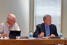"""<div class=""""source"""">KACIE GOODE/The Kentucky Standard</div><div class=""""image-desc"""">Brent Holsclaw and Jim Roby listen during Tuesday's meeting of the Bardstown Independent Schools Board of Education.</div><div class=""""buy-pic""""><a href=""""/photo_select/88496"""">Buy this photo</a></div>"""