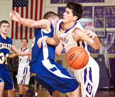 """<div class=""""source"""">Peter W. Zubaty</div><div class=""""image-desc"""">Bardstown's Nicolas DeVillalobos, right, takes a hard foul from Bethlehem's Zack Coniff during the Tigers' 59-38 win Tuesday. Bardstown visits Thomas Nelson and Bethlehem hosts Nelson County in a pair of district doubleheaders tonight.</div><div class=""""buy-pic""""></div>"""
