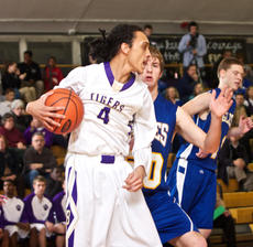 """<div class=""""source"""">Peter W. Zubaty</div><div class=""""image-desc"""">Bardstown's Jalen Stone (4) clears a rebound during the second quarter Tuesday against Bethlehem. Stone got all 10 of his points in the second quarter and dished out a key assist to spark an 18-5 run.</div><div class=""""buy-pic""""></div>"""