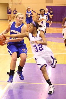 "<div class=""source"">Peter W. Zubaty</div><div class=""image-desc"">Bardstown's Karis Rogers (right) hassles Bethlehem's Olivia Simpson on a drive to the basket Tuesday. The Tigers hung on for a 44-40 win, their first district victory of the season.</div><div class=""buy-pic""><a href=""http://web2.lcni5.com/cgi-bin/c2newbuyphoto.cgi?pub=191&orig=beth_bhs_gb_01.JPG"" target=""_new"">Buy this photo</a></div>"