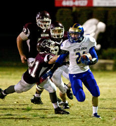 "<div class=""source"">PETER W. ZUBATY/The Kentucky Standard</div><div class=""image-desc"">Bethlehem's Jake Yates (21) piled up 1,479 combined rushing and receiving yards and 26 total touchdowns as a junior. He'll need to come up even bigger after the graduation of District 2 Player of the Year Connor Ballard, who led the Eagles to one of their best seasons in school history.</div><div class=""buy-pic""></div>"