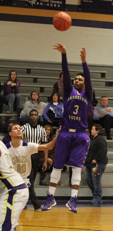"<div class=""source"">Dennis George/Contributing Photographer</div><div class=""image-desc"">Bardstown's Marcus Cosby lofts up a jumper against Campbellsville.</div><div class=""buy-pic""></div>"