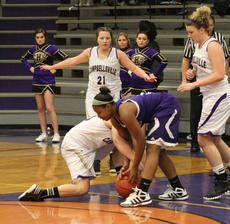 "<div class=""source"">Dennis George/Contributing Photographer</div><div class=""image-desc"">Bardstown's Kasia Stone (center, in purple) fights for a loose ball with a Campbellsville player Monday. Stone had 19 points and nine rebounds for the Tigers, and hit the game-winning layup and followed that with a steal to clinch the 56-54 win. </div><div class=""buy-pic""></div>"