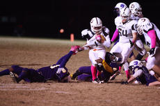 "<div class=""source"">Peter W. Zubaty</div><div class=""image-desc"">Bardstown's Tyrone Mudd (left) hangs on to DeSales' Nathan Roush's jersey for one of his 18 tackles on the night, this one with an assist from Deion Tonge.</div><div class=""buy-pic""><a href=""http://web2.lcni5.com/cgi-bin/c2newbuyphoto.cgi?pub=191&orig=bhs_desales_fb.jpg"" target=""_new"">Buy this photo</a></div>"