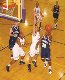 """<div class=""""source"""">Peter W. Zubaty</div><div class=""""image-desc"""">Bardstown's Cody Ramos's defense forced a turnover on this play by Elizabethtown's Chris McDonald. The Tigers came back from 21 down in the second half to win, 67-65.</div><div class=""""buy-pic""""><a href=""""/photo_select/23520"""">Buy this photo</a></div>"""