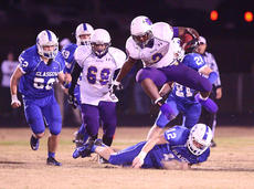 "<div class=""source"">PETER W. ZUBATY/The Kentucky Standard</div><div class=""image-desc"">Bardstown's Donshais Calbert hurdles Glasgow's Connor Glass (12) on a second-half run. The Tiger senior ended his career with a monster game, rushing for 118 yards and four touchdowns in a losing effort.</div><div class=""buy-pic""><a href=""http://web2.lcni5.com/cgi-bin/c2newbuyphoto.cgi?pub=191&orig=bhs_glasgow_fb_11_conv.jpg"" target=""_new"">Buy this photo</a></div>"