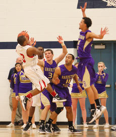 """<div class=""""source"""">Peter W. Zubaty</div><div class=""""image-desc"""">Bardstown defenders slow up John Hardin's Brandon Price (3) on this drive to the bucket, but Price had the final say with a 37-point, seven-assist performance in the Bulldogs' 74-66 region championship win Tuesday, earning him tourney MVP honors.</div><div class=""""buy-pic""""><a href=""""http://web2.lcni5.com/cgi-bin/c2newbuyphoto.cgi?pub=191&orig=bhs_jh_bbregchamp_01.JPG"""" target=""""_new"""">Buy this photo</a></div>"""