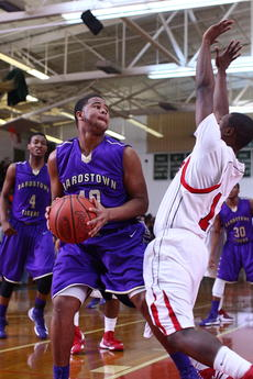 "<div class=""source"">Peter W. Zubaty</div><div class=""image-desc"">Bardstown's Jayquez Smith, left, gave his team solid minutes off the bench Monday against John Hardin, scoring four points.</div><div class=""buy-pic""></div>"
