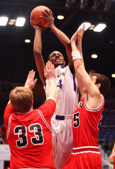 "<div class=""source"">PETER W. ZUBATY/The Kentucky Standard</div><div class=""image-desc"">Bardstown's Devonte Grundy takes on two Richmond Model defenders for a second-half bucket in Friday's Touchstone Energy All A Classic quarterfinals in Frankfort. Grundy delivered a second straight double-double — scoring 31 points and grabbing 12 boards, both game-highs — to help lift his team past the Patriots and into Saturday's semifinals against Bishop Brossart. Should the Tigers win Saturday, they would be in action in Sunday's championship at 2:30 p.m. against either Newport Central Catholic or Knott County Central.</div><div class=""buy-pic""><a href=""http://web2.lcni5.com/cgi-bin/c2newbuyphoto.cgi?pub=191&orig=bhs_model_bb_alla_03.JPG"" target=""_new"">Buy this photo</a></div>"