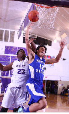 "<div class=""source"">Peter W. Zubaty</div><div class=""image-desc"">Bardstown's Seivon Schooling gets a piece of the ball, and a piece of North Hardin's Tyler Landry on a fast break. The Tiger junior tallied six points and 12 rebounds.</div><div class=""buy-pic""></div>"
