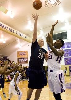 "<div class=""source"">Bruce Nichols/Contributing Photographer</div><div class=""image-desc"">Mason Flechler puts up a shot for Thomas Nelson against Bardstown's Seivon Schooling.</div><div class=""buy-pic""></div>"