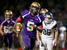 <div  />PETER W. ZUBATY/The Kentucky Standard</div><div>Bardstown's Voshon Livers pulls away from the Thomas Nelson defense for a 50-yard touchdown run in the second quarter of the Tigers' 36-7 win Friday. The victory was the 600th in school history for Bardstown, making it one of just 16 schools in Kentucky to have reached that milestone.</div><div></div>