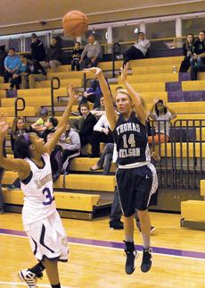 "<div class=""source"">Bruce Nichols/Contributing Photographer</div><div class=""image-desc"">Thomas Nelson's Hannah Wolf lofts up a shot against Bardstown Friday.</div><div class=""buy-pic""></div>"