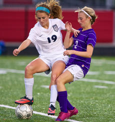"<div class=""source"">PETER W. ZUBATY/The Kentucky Standard</div><div class=""image-desc"">Thomas Nelson's Claire Hicks (19) dances with the ball and Bardstown's Katie Sidebottom during the Tigers' 1-0 win in the 19th District semifinals. The Tigers' win stopped a 19-match win streak by the Generals, who were the top-scoring team in Kentucky this season.</div><div class=""buy-pic""></div>"