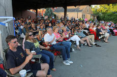 "<div class=""source"">RANDY PATRICK/The Kentucky Standard</div><div class=""image-desc"">A large audience attended the Bardstown Tiger Chorale's memorial concert for the Netherlands Saturday night at the Bardstown Farmers Market.</div><div class=""buy-pic""><a href=""http://web2.lcni5.com/cgi-bin/c2newbuyphoto.cgi?pub=191&orig=big_audience_3.jpg"" target=""_new"">Buy this photo</a></div>"