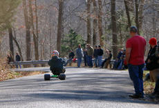 "<div class=""source"">KACIE GOODE/The Kentucky Standard</div><div class=""image-desc"">A racer flies around a curve on Cissal Hill Road Sunday afternoon while taking part in the annual Big Wheel Race.</div><div class=""buy-pic""><a href=""/photo_select/91237"">Buy this photo</a></div>"