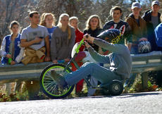 "<div class=""source"">KACIE GOODE/The Kentucky Standard</div><div class=""image-desc"">A racer flies around a curve on Cissal Hill Road Sunday afternoon while taking part in the annual Big Wheel Race.</div><div class=""buy-pic""><a href=""/photo_select/91241"">Buy this photo</a></div>"
