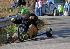 "<div class=""source"">KACIE GOODE/The Kentucky Standard</div><div class=""image-desc"">A racer flies around a curve on Cissal Hill Road Sunday afternoon while taking part in the annual Big Wheel Race.</div><div class=""buy-pic""><a href=""/photo_select/91242"">Buy this photo</a></div>"