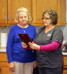 """<div class=""""source"""">DENNIS GEORGE/Contributing Photographer</div><div class=""""image-desc"""">Bloomfield Mayor Rhonda Hagan presents a service award to Sue Case. Case was a member of the Bloomfield City Council for one term that ended on Dec. 31.</div><div class=""""buy-pic""""><a href=""""/photo_select/83305"""">Buy this photo</a></div>"""