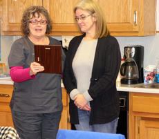 """<div class=""""source"""">DENNIS GEORGE/Contributing Photographer</div><div class=""""image-desc"""">Bloomfield Mayor Rhonda Hagan, presents a service award to former city councilwoman Tammy Wimpsatt. Wimpsatt was recognized for her contributions after serving three terms on the town's city council.</div><div class=""""buy-pic""""><a href=""""/photo_select/83306"""">Buy this photo</a></div>"""