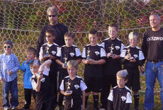 """<div class=""""source""""></div><div class=""""image-desc"""">The 2011 Fall U-10 Soccer Tournament Champions were named. Pictured are front row from left, Cambron Rogers, Grant Amshoff and Walker Settles. Middle row: Grant Johnson, Lane Grace, Tyler Healey, D.J. Muncy and Xavier Cheek. The team was coached by assistant coach David Brauch and head coach Jason Cheek. Not present in the photo was Ted Garrett.</div><div class=""""buy-pic""""></div>"""