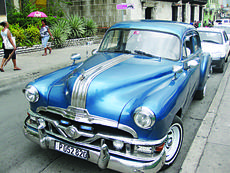"<div class=""source""></div><div class=""image-desc"">Vintage American cars like this Pontiac in Santiago de Cuba are everywhere in the island nation. The Cubans take pride in keeping them  in good condition.</div><div class=""buy-pic""><a href=""/photo_select/78568"">Buy this photo</a></div>"