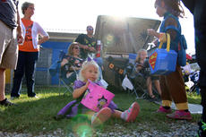 """<div class=""""source"""">KACIE GOODE/The Kentucky Standard</div><div class=""""image-desc"""">A tiny trick-or-treater sits down and enjoys her spoils Saturday at Boo Haven, a trunk-or-treat event at New Haven School.</div><div class=""""buy-pic""""><a href=""""/photo_select/90070"""">Buy this photo</a></div>"""