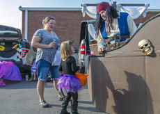 """<div class=""""source"""">KACIE GOODE/The Kentucky Standard</div><div class=""""image-desc"""">A pirate welcomes trick-or-treaters Saturday evening during Boo Haven, a trunk-or-treat event supporting the New Haven School PTO.</div><div class=""""buy-pic""""><a href=""""/photo_select/90075"""">Buy this photo</a></div>"""