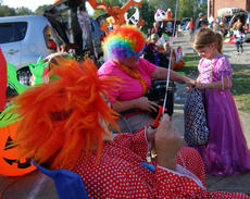 """<div class=""""source"""">KACIE GOODE/The Kentucky Standard</div><div class=""""image-desc"""">A trick-or-treater receives a treat Saturday during Boo Haven and New Haven School.</div><div class=""""buy-pic""""><a href=""""/photo_select/90076"""">Buy this photo</a></div>"""