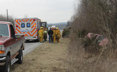 "<div class=""source"">RANDY PATRICK/The Kentucky Standard</div><div class=""image-desc"">The Boston Volunteer Fire Department responded to an overturned Toyota Camry Wagon on U.S. 62 near the Hardin County line Tuesday. The accident was reported at 1:50 p.m. Deputy Sheriff Brian Voils reported that the driver, Sturgeon Leathers, 86, of Bardstown, was westbound when he lost control of the SUV, went over the embankment, hit some trees and spun around. Nelson County EMS responded, but the patient refused treatment.</div><div class=""buy-pic""><a href=""/photo_select/93031"">Buy this photo</a></div>"
