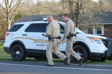 """<div class=""""source"""">RANDY PATRICK/The Kentucky Standard</div><div class=""""image-desc"""">Sgt. Ramon Pineiroa and Deputy Brandon Bryan walk back toward the  patrol cars from the scene of a fatal accident on Springfield Road Thursday.</div><div class=""""buy-pic""""></div>"""