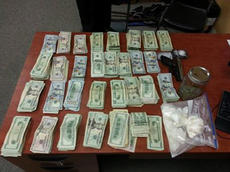 """<div class=""""source"""">SUBMITTED PHOTO</div><div class=""""image-desc"""">Police seized around $29,000 in cash, approximately 400 grams of cocaine, scales and a 9 mm handgun from 103 Atlantic Court Monday. The cocaine has a reported street value of $40,000.</div><div class=""""buy-pic""""></div>"""