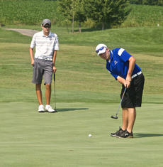"<div class=""source"">PETER W. ZUBATY/The Kentucky Standard</div><div class=""image-desc"">Bethlehem's Corey Robinson sizes up a putt while Thomas Nelson's Cody French observes during Thursday's Kickin' Chicken Classic scrimmage match at Maywood. The Generals and Eagles figure to contend for local supremacy on the links.</div><div class=""buy-pic""></div>"