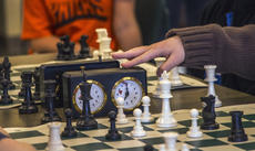 "<div class=""source"">KACIE GOODE/The Kentucky Standard </div><div class=""image-desc"">A clock is added as the first round approaches time Saturday during the Bardstown Optimist chess tournament. </div><div class=""buy-pic""><a href=""/photo_select/83109"">Buy this photo</a></div>"