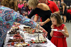 """<div class=""""source"""">KACIE GOODE/The Kentucky Standard</div><div class=""""image-desc"""">A young guest considers her choices Saturday at the chocolate buffet. The Chocolate Extravaganza, held for the second year at the Guthrie Opportunity Center, supports The New Life Center in Bardstown.</div><div class=""""buy-pic""""><a href=""""/photo_select/93328"""">Buy this photo</a></div>"""