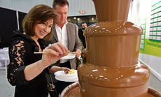 """<div class=""""source"""">KACIE GOODE/The Kentucky Standard</div><div class=""""image-desc"""">Guests try out the chocolate fountain as the lines open Saturday night for the Chocolate Extravaganza.</div><div class=""""buy-pic""""><a href=""""/photo_select/93329"""">Buy this photo</a></div>"""